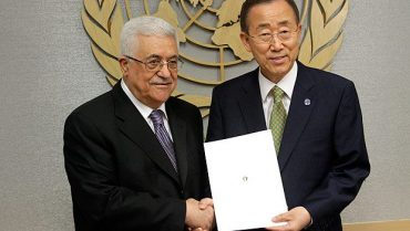 Palestinian President Mahmoud Abbas, left, poses for a picture with Secretary-General Ban Ki-moon. (AP Photo/Seth Wenig)