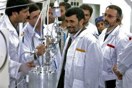 Iranian President Mahmoud Ahmadinejad inspects the Natanz nuclear plant in central Iran